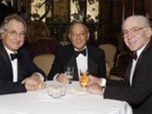 Bernard Madoff (left) treasurer and chairman of the board of Sy Syms School of Business at Yeshiva University with his vice chairman Sy Syms (center) and Josh S. Weston.
