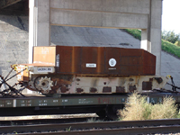 This radioactive tank sitting exposed on a flatbed railroad car in Topeka, Kansas, should have been 'encapsulated,' according to U.S. Army Regulation 700-48. Photo: Chris Bayruh