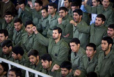 Revolutionary Guards force shout support for Iran's nuclear program at Friday prayers in Tehran Nov 23, 2007