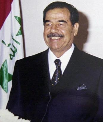 A photo of Saddam while he was still in power; note the fine dental work.