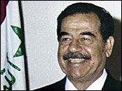 In contrast to the near perfect set of dentures he displays in this 2002 photo. Clear evidence that the man on trial in Baghdad is not the real Saddam Hussein.