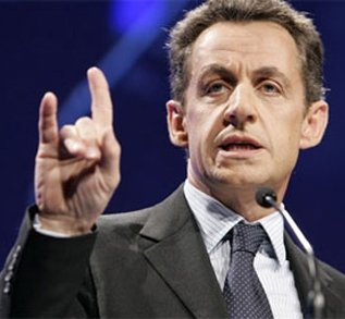 Sarkozy throws notorious hand sign.