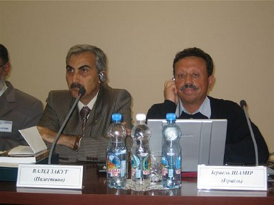 The writer Israel Shamir (seated left), at a recent conference in the Ukraine.