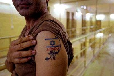 A tattoo flaunted inside the notorious Abu Ghraib