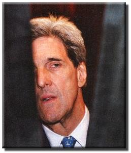 Unaware that he has been observed, Kerry watches from the sidelines during a debate recently