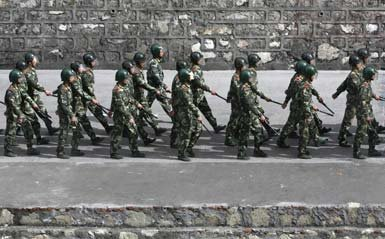 Chinese riot police march into Kangding, Tibet.