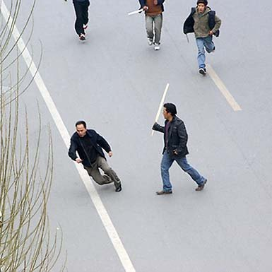 Tibetan youths converge on a Han Chinese man in Lhasa.