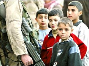 American Soldier's Holding Iraqi Children as Pawns