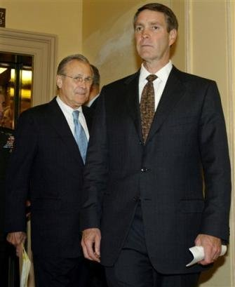 Donald Rumsfeld follows Bill Frist out of a press breifing in Washington, September 22, 2004. Note the look on Rumsfeld's face: he looks sheepish and it speaks volumes about who the real power behind the scenes in Washington really is.