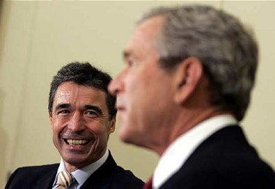 Photo: Brother in arms and acts of aggression, Danish Prime Minister Anders Fogh Rasmussen and U.S. President George W. Bush. The worldwide Muslim reaction to the blasphemous cartoons of Flemming Rose will only get worse - and cost Denmark more - until Rasmussen issues a formal and sincere apology for having offended Muslims. The Queen of Denmark should also apologize and beg forgiveness of the world's Muslims. Otherwise the wound caused by the Danish insult will never heal. An apology is the ONLY way out of this crisis.
