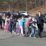 Drill at Sandy Hook. If 20 children & 6 teachers had actually been slaughtered, they would be running away in terror. Click to enlarge