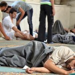 "Scene from an alleged Syrian chemical weapons attack: ""Some thought it odd that none of the medical personnel were wearing protective clothing, since sarin gas – which activists say was used in the attack – can be transferred from those already afflicted, with deadly effect... """
