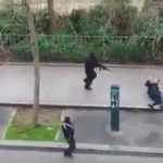 Video still of gunmen shooting a wounded policeman near the offices of Charlie Hebdo, Paris. Click to enlarge