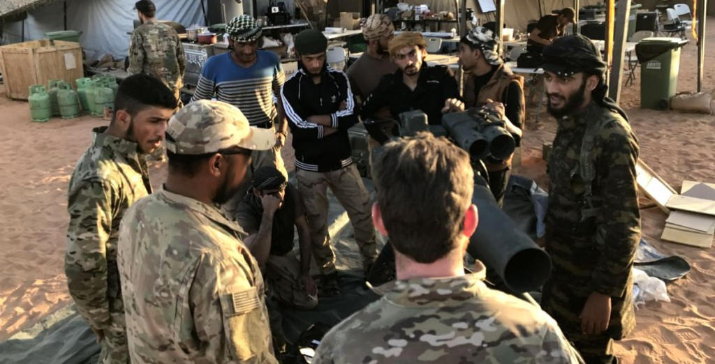 Unidentified U.S.-backed Syrian rebels surround a piece of artillery during training by American special forces member in Southeastern Syria near Tanf. Photo | Hammurabi's Justice News. Click to enlarge