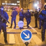 Armed French police block access to the streets in Meinau district in Strasbourg, during the manhunt. Click to enlarge