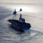 A Japanese helicopter carrier, Kaga, trails behind Japanese destroyer Inazuma led by the British frigate HMS Argyll in the Indian Ocean; Japan's Prime Minister Shinzo Abe hopes to upgrade the helicopter carriers so they can launch fighter jets. Click to enlarge