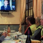 Yellow vest protesters watch President Emmanuel Macron's speech on TV in Fay-au-Loges. Click to enlarge