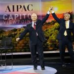Senator Ben Cardin (D-MD) and Senator Lindsey Graham (R-SC) (right) join hands as they take the stage to address the American Israel Public Affairs Committee (AIPAC) policy conference in Washington, March 2015. Click to enlarge