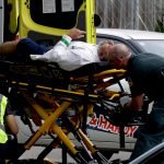 """Ambulance staff take a man from outside a mosque in central Christchurch, New Zealand, Friday, March 15, 2019.  Multiple people were killed in mass shootings at two mosques full of worshippers attending Friday prayers on what the prime minister called """"one of New Zealand's darkest days,"""" as authorities detained four people and defused explosive devices in what appeared to be a carefully planned attack. (AP Photo/Mark Baker)"""
