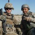 """Then-captain Danny Sjursen (left) pausing during a patrol with his interpreter, """"Ali,"""" in Kandahar, Afghanistan in 2011"""