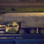China's land-based DF-41 intercontinental ballistic missile will be among the military hardware on show on October 1. Photo shows a covered DF-41 launcher taking part in a nightime rehearsal for the parade. Click to enlarge