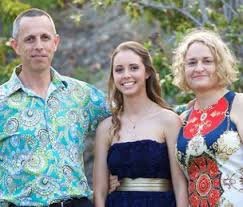 Fiona Barnett, right, with daughter and husband)