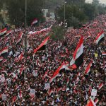 Iraqis march in Baghdad to protest the continued U.S. military oresence in their country. Click to enlarge