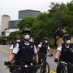 Police officers in protective masks prepare as protesters against the state's extended stay-at-home order to help slow the spread of the coronavirus disease (COVID-19) demonstrate at the Capitol building in Austin, Texas, U.S., April 18, 2020. REUTERS/Callaghan O'Hare - RC267G9ZKRKS