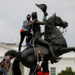 Protestors prepare to pull down a statue to Andrew Jackson. Click to enlarge