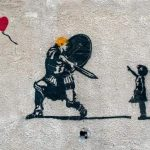 Banksy-style graffiti on a wall on the outskirts of Damascus