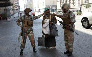 Armed sexurity force personnel ensure the Covid-19 lockdown is adhered to in central Jo'burg. Click to enlarge