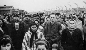 The inmates of a Polish concentration camp: shortly after the camp was overun by advancing Soviet forces and the captives were released. Note the absence of any emaciated figures here