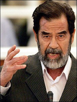 Saddam in the court in the Green Zone yesterday and again, note the dodgy dental work...